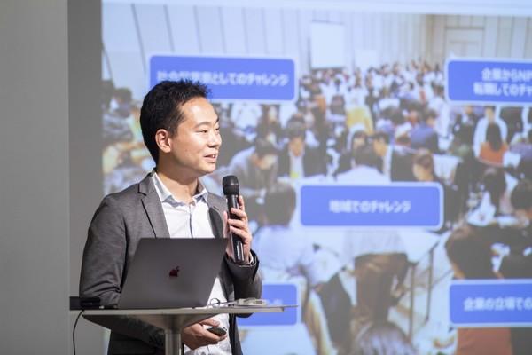 JAPAN COLLECTIVE IMPACT in 渋谷でコレクティブインパクトの概要を説明する番野智之氏